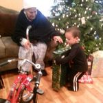 Great grandson David opening her Christmas present 12/25/12