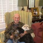Grandpa with three furry grandkids
