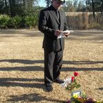 Tony (son) saying a few words over dad's grave.