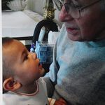 Deep in conversation with grandson Mateo.