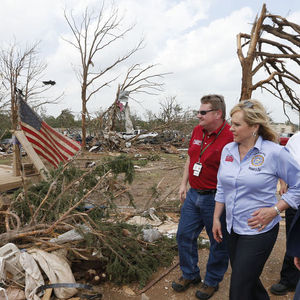 Oklahoma Gov. Mary Fallin, right, walks through the Steelman Estates Mobile Home Park, which was hard hit in Sunday&#39;s tornado, with Albert Ashwood, left, Director of the Oklahoma Department of Emergency Management, near Shawnee, Okla., Monday, May 20, 2013. 