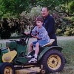 Grandpa teaching Kyle to drive the old tractor