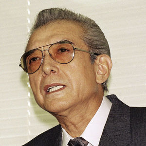 In this Friday, June 12, 1992 file photo, Hiroshi Yamauchi, then-president of Japan's Nintendo Co., answered questions during a news conference after he won the final approval to buy the Seattle Mariners at the company's head office in Kyoto, western Japan. Yamauchi, who ran Nintendo for more than 50 years and led the company's transition from traditional playing-card maker to video game giant, has died of pneumonia, Thursday, Sept. 18, 2013. He was 85.