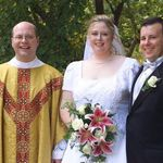 Fr. Cramer with Peter & Kassie at their wedding