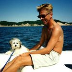 Stoney with his Dad on a boat ride around Lake Michigan. He loved the water!!