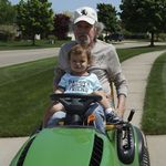 Dad and Grandson Andrew on lawnmower together