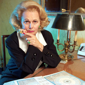 In this file photo from March 15, 1990, astrologer Joan Quigley is seen with charts she uses in her work at her residence in San Francisco. Joan Quigley, the San Francisco astrologer who helped determine President Ronald Reagan's schedule and claimed to have convinced him to soften his stance toward the Soviet Union, has died at the age of 87. (AP Photo/Eric Risberg)