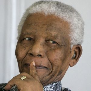 Former South African President Nelson Mandela looks on during The Mandela Rhodes Foundation 90 birthday celebration for the former president at one of his residence in Cape Town, South Africa, Wednesday, Aug. 20, 2008