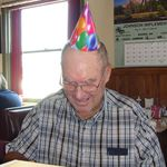 Surprising Claris on his 80th birthday at the cafe.
