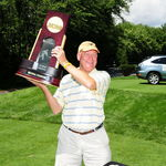 John holding the 2008 Nation Championship trophy at last year&#39;s Pike&#39;s Peak golf tournament.