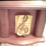 The urn of Janice's cremains that her widower husband, Daryl has...with the music treble clef on it. Janice used her musical talents to Praise The Lord.