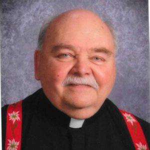 Rev. Mark A.  Fracaro