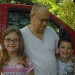 Jim with his grandkids Jessica and Sebastian