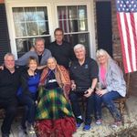 Dad with Family members on Front Porch