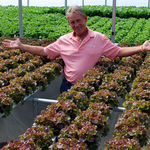 """I asked Lester to look proud for this photo. In a split second he spread his arms as if to say, """"Look at all of this!"""" I snapped the photo just in time to capture his joy and love for his hydroponics venture. Like a kid in a candy store."""