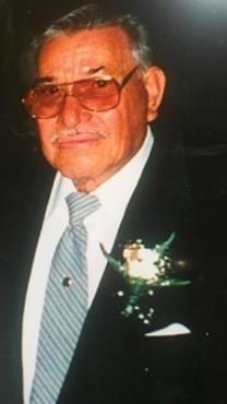 Manuel C. Flores obituary photo