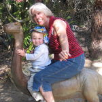 Riding the baby brontosaurus at Quail Gardens with Tad