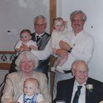Joe with three of his children holding their own grandchildren.