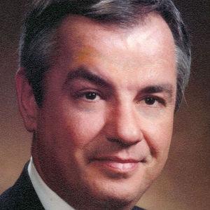 DAVID T.  WARREN