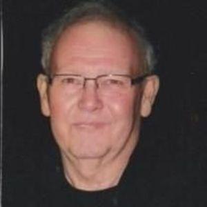 James E. Dollins