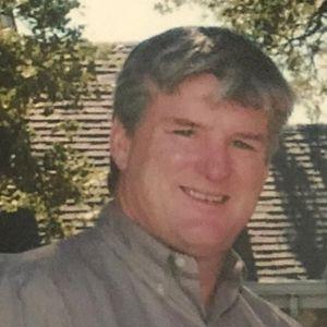 Mr. Brett T. Martin