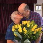 John kissing his bride of 50 years.  Can't you see the love they both have for each other!