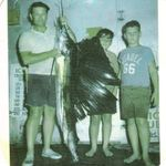 Dad, Ricky Presnell & Jimmy VanNess with the sailfish dad caught (Now over the fireplace)