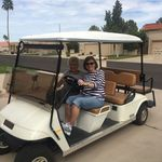 Grandma Virge and Susie riding the golf cart in Arizona