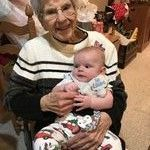 Grandma Virge holding her great-great grandson on his first Christmas