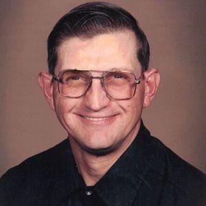 Raymond E.  Portner