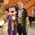 Posing with Mickey on a Disney Cruise