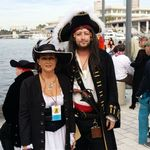 Suzy and Perry at Gasparilla Pirate Festival in Tampa. Suzy made the pirate clothes and hats for herself and Perry!
