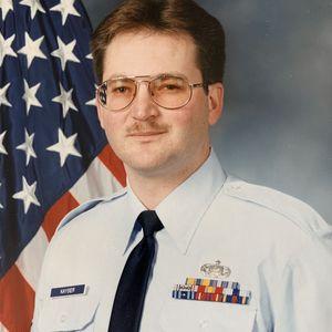 Mark  E.  Kayser