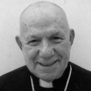 Rev.  John Dias C.S.C.