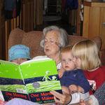 Deedie reading to Ayley, Jessa, and Samara Shortridge (an activity they all greatly enjoyed).