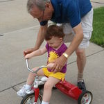 July 4, 2011 PaPa helps Maria with her tricycle