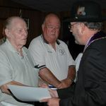 Bob receiving 25-Year Membership Pin in 2010 from Tim Legarth, District Deputy to the Grand Master.