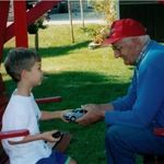 Grandpa Ray with Michael on the Swing