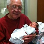 Dad holding his newborn Great Grandson Max February 28, 2012.