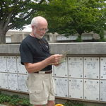Reading a tribute to his parents at Arlington National Cemetery, 2008