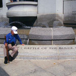 Dad sitting by the Battle of the Bulge engraving at the WWII Memorial