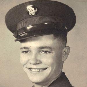 Marvin J.  Plooster