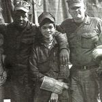Charlie (far left) during duty as a Seabee in Vietnam with the 121st MCB.