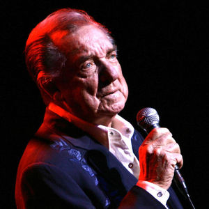 In this March 10, 2007 file photo, Ray Price performs at the Aladdin Theater for the Performing Arts in Las Vegas. Price, one of country music's most popular and influential singers and bandleaders who had more than 100 hits and was one of the last living connections to Hank Williams, died Monday, Dec. 16, 2013. He was 87.