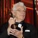 In this Nov. 14, 2009 file photo, cinematographer Gordon Willis poses with his honorary Oscar following The Academy of Motion Picture Arts and Sciences 2009 Governors Awards in Los Angeles. An official at the Chapman Cole & Gleason funeral home in Falmouth, Mass. on Monday, May 19, 2014 confirmed that Willis, one of Hollywood's most celebrated and influential cinematographers, has died. He was 82.