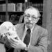 In a May 5, 1986 file photo, Dr. Clyde Snow holds a human skull in his office in Oklahoma City, Okla. Snow, a forensic anthropologist who worked on cases ranging from the assassination of President John F. Kennedy to mass graves in Argentina, died Friday, May 16, 2014, at Norman Regional Hospital in Norman, Oklahoma,, says his wife, Jerry Snow. He was 86.