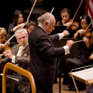 In this photo provided by the New York Philharmonic, guest soloist Sir James Galway performs on flute as Lorin Maazel conducts the New York Philharmonic during the orchestra's gala opening night concert in Avery Fisher Hall at Lincoln Center Wednesday, Sept. 17, 2008, in New York. (AP Photo/New York Philharmonic/Chris Lee)