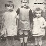 Martha with her brother and sister, growing up in Germany.  Isn't she a cutie !!!