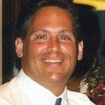 Mark A. Denny