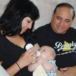 Auntie Liza feeding baby Carson